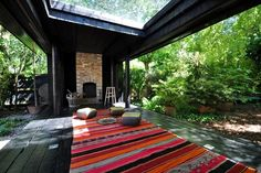 Outdoor yoga room. Love the glass roof for rainy days. Uh... Yes. Please.