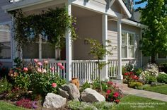 Front porch ideas - how about landscaping with rocks? A few large boulders make a year around statement.