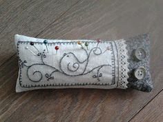 gray bird with buttons pincushion.
