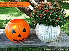 DIY Halloween music sheet planter from a plastic pumpkin!  Perfect fall decorations at eclecticallyvintage.com  http://eclecticallyvintage.com/2012/09/1-pumpkin-music-sheet-planter/