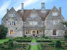 The Manor is a charming early Century Jacobean style Manor House, crafted from Blue Lias stone with Cotswold stone dressings. Set within two acres of beautifully maintained formal gardens and. Formal Gardens, Holiday Accommodation, Luxury Holidays, Large Homes, House Party, Acre, Cabin, Mansions, House Styles