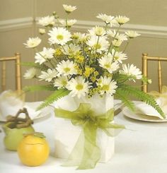Summer or spring bridal shower decorations...white daisies go with any decor, just change the colour of the vase or bow :)