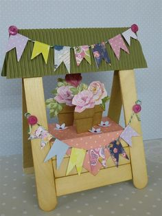 Handmade Flower stand card using lollipop sticks.