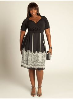 With this 5X pus size black and white dress with lace print detail you're wearing an empire dress with super fashion and femininity to work!