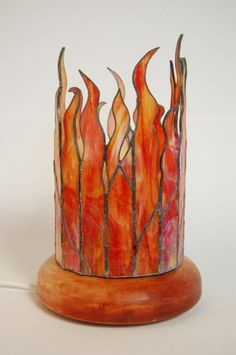 Colorful flames. I don't know what this is. A candle holder?