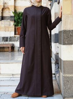 Pleated Jilbab Save 36% 70 Percent Cocoa color  Delicate, graceful, and rich in its very modest look and feel, the details on this piece are sure to impress. The perfectly placed pleats add lovely texture, while the clean lines keep the silhouette linear and modest. Side pockets and a buttoned opening make this jilbab as practical as it is pretty.