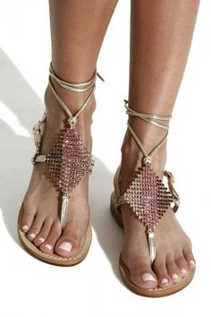 Wearing the sandals with gold-coloured straps you will be the star of every beach party!