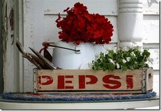 Create with red lettering, red & white enamel pot and red flowers