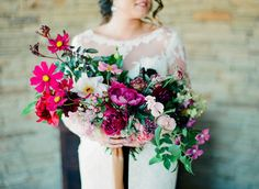 jewel toned Bridal bouquet with pink cosmos, burgundy peonies, red dahlias, and chocolate cosmos at a Wildcatter Ranch boho Wedding in Graham Texas. Planned and designed by Birds of a Feather Events. To see more from this wedding, click here: http://birds-of-a-feather-events.com/wildcatter-ranch-wedding-sammie-hayden/