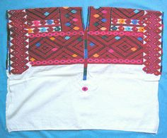 Tenejapa Huipil    This Tzeltal Maya woman's huipil is from Tenejapa Chiapas. The design is embroidered rather than woven into the fabric