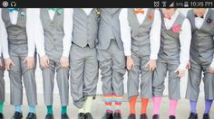 Colorful groomsmen. Mix matched socks, bow ties, and boutonnieres