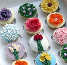 These cupcakes were made for my son's birthday. Of course the flower cupcakes were for the girls, and you guessed it, the footballs for the. Flowers Cupcakes, Cupcakes Flores, Garden Cupcakes, Spring Cupcakes, Floral Cupcakes, Pretty Cupcakes, Beautiful Cupcakes, Yummy Cupcakes, Edible Flowers