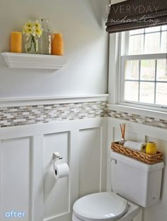 I love this bathroom re-do! Before the walls were plain and rust colored; the vanity was an oak color. This is such a great change!