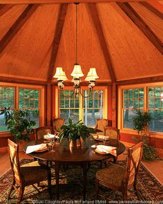 A beautiful post and beam octagonal dining room.