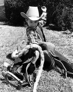 Ride 'em cowboy! Here's to starting young! practicing to be a rodeo champion..