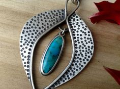 I handcrafted this turquoise necklace in sterling silver. I have oxidized the piece then sanded and wire brushed it to a satin finish. SALE WAS $140.00 NOW $90.00  *the turquoise has been dyed and stabilized. The focal piece of the necklace measures 2 1/2 long (64mm) x 1 5/8 (42mm) wide. The sterling silver rolo chain is adjustable from 18 to 20 long.  * Ready to ship in 1-2 business days  Your jewelry comes ready to gift in a lovely Q2 gift box!  As always, if you have questions, w...
