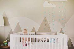 This nursery has a wall mural – Kimmy & Bear