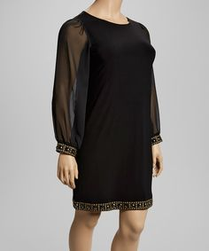 Step out stylishly in an elegant look with just the hint of allure. This chic, body-skimming dress features sheer, loose-fitting sleeves and shimmering beaded hem, crafting the perfect flirty piece for a date night or drinks with the girls.Measurements (size 14W): 38'' long from high point of shoulder to hemMannequin measurements: 5' 5'' tall; 43.5'' chest; 33'' waist; 43'' hips95% polyester / 5% spandexHand washImported