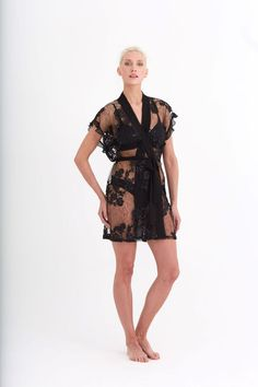 940a7d884 The beautiful Charming Cover Up features allover lace embroidered with  sequin detail. The cover up