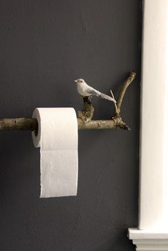 Decorating is for the birds! Love this toilet paper holder made out of a tree branch. http://blogs.lowellsun.com/daleydecor/2014/08/29/decorating-is-for-the-birds/