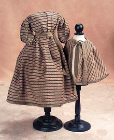 Superb Bengaline Silk Gown with Matching Cape Richly-woven bengaline silk in bronze,black & red pattern w/slightly textured finish, full skirt that is dart-shaped at the front and cartridge-pleated at the back. Along with a matching cape. Circa 1865.