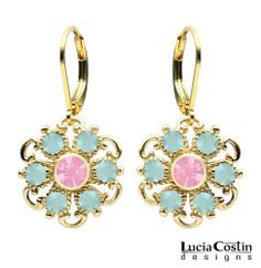 Lucia Costin 14K Yellow Gold Plated over .925 Sterling Silver Expressive Dangle Earrings with Light Pink, Mint Blue Swarovski Crystals Surrounded by Dots and Twisted Lines Lucia Costin. $48.00. Dangle earrings by Lucia Costin. Unique and feminine, perfect to wear for special occasions and evenings. Produced delicately by hand, made in USA. Romantic floral design. Garnished with light rose and blue opal Swarovski crystals