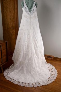 Jasmine T162009: buy this dress for a fraction of the salon price on PreOwnedWeddingDresses.com