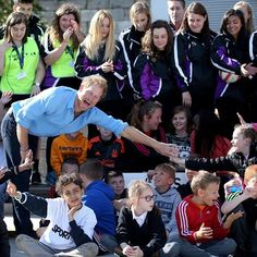 Prince Harry meets pupils from Kaimhill School and volunteers from the Streetsport charity during a visit to Robert Gordon University in Aberdeen.  Streetsport delivers free weekly sports and creative activity sessions for young people throughout Aberdeen City by deploying mobile activity arenas directly into local communities and operating during peak times of anti-social behaviour.
