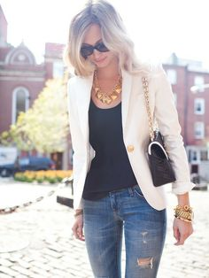 Black tee, denim and white blazer topped with gold accessories.