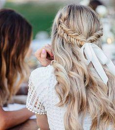 half undo with fishtail braid & white ribbon.
