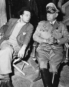 "Director Billy Wilder with actor/director Erich von Stroheim on the set of ""FIVE GRAVES TO CAIRO"" (1943)."
