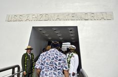 """PEARL HARBOR (Dec. 7, 2011) Paul DePrey (left), superintendent of the WWII Valor in the Pacific National Monument, and Rear Adm. Frank Ponds, Commander, Navy Region Hawaii, welcome Pearl Harbor survivors to the USS Arizona Memorial during a U.S. Navy and National Park Service joint memorial ceremony in commemoration of the 70th anniversary of the attack on Pearl Harbor. This year's theme of the ceremony was """"The Enduring Legacy: Pearl Harbor 1941-2011."""" (U.S. Navy Photo by MC2 Daniel Barker)"""