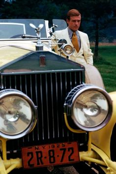 Robert Redford as Jay Gatsby and the infamous yellow Rolls Royce, photographed by Duane Michals for Vogue (December 1973).