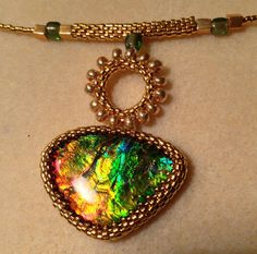 Ammolite with gold japanese pearls