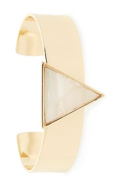 This sleek and modern cuff bracelet features a triangular inlay made from shimmering mother-of-pearl.