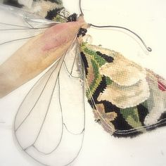 Clear winged moth soft sculpture with tapestry detail.