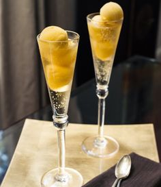 Using an ice cream scoop,place 2-3 scoops of mango sorbet in each cocktail glass. Pour in sparkling wine or champagne. Serve immediately.