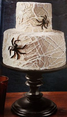 Halloween spider web cake - webs are made with stringed marshmallows. Microwave marshmallows until gooey (30 seconds) stir then pinch off pieces and string over cake