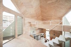 Tiny Tsubomi House is a Multi-Level Residence that Blooms Atop a Cookie Shop