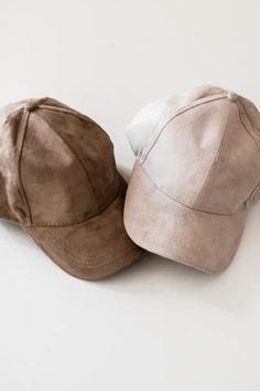 Classic baseball cap with a soft faux suede texture. Adjustable buckle in back…