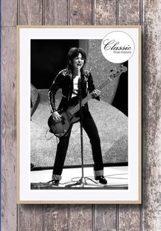 Pop singer Suzi Quatro in concert in London in the mid 1970s. A rare photo recently discovered and restored by our technicians to it's original condition Photo captured by photographer Anwar Hussein. Copyright © Anwar Hussein 1975 all rights reserved. #suziquatro #popmusic #1970s #devilgatedrive #canthecan #70spop #cool #popular #topofthepops #inconcert