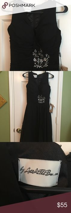 Special occasion dress NWT-Beautiful black dress can be worn for an special occasion Light in the box Dresses Midi