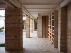 Completed in 1971 as a summer house for Danish architect, Jørn Utzon, Can Lis sits upon the edge of Mallorca's windswept coastline. The house is made up of four discrete pavilions, which are linked by courtyards and stepping stones. Moving from room to room involves meandering through open spaces framed only by landscaped walls, bare branches and sky.