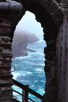 Tintagel Castle, perched on a hillside overlooking the turbulent Atlantic.  Cornwall, England