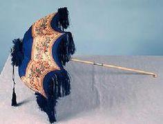 "A circa 1850 printed silk parasol with ivory handle, royal blue with cream floral border print, silver handle band marked ""Sangsters"", deep silk fringe. Lace Umbrella, Vintage Umbrella, Under My Umbrella, Victorian Era, Victorian Fashion, Vintage Fashion, Victorian Dollhouse, Modern Dollhouse, Antique Fans"