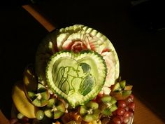 Fruit Carving - Vegetable Carving - Fruit Carving Arrangements and Food Garnishes: Wedding Watermelon With a Kissing Pair On It