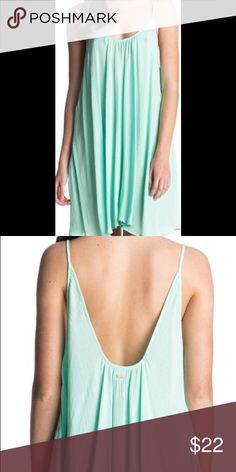 Roxy Sweet Vida Seafoam Cover-up Living the summer life is easy and breezy whenever you throw on this flowy cover up. Thin straps and a stunning scoop back combine with lightweight viscose fabric to create its full sweep design. A tiny Roxy logo decorates the scoop back to show off your favorite brand. Worn as a fashionable cover-up over your swimsuit or as a casual daytime dress with a denim jacket and wedges, the Roxy Sweet Vida Cover Up is sure to look as sweet as you do. US Women's Size…