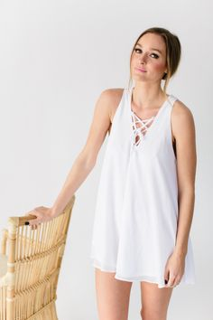 White criss cross sleeveless dress: http://www.stylemepretty.com/living/2016/12/30/4-tips-for-the-cutest-ever-non-traditional-new-years-eve-party/  Photography: Heather Kincaid - http://heatherkincaid.com/