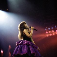 1987: Performing in a big purple skirt.