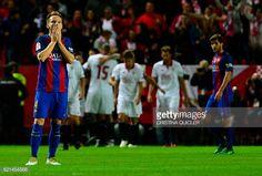 Barcelona's Croatian midfielder Ivan Rakitic reacts after Sevilla's midfielder Vitolo scored during the Spanish league football match Sevilla FC vs...